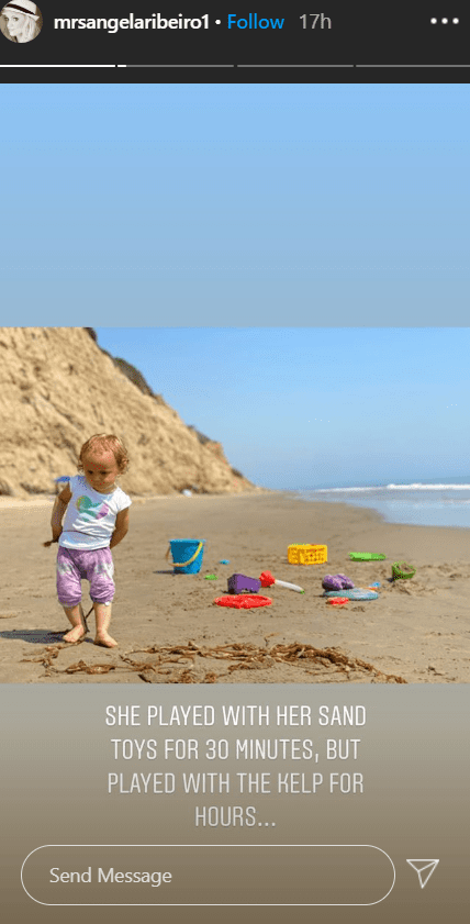 A picture of Alfonso Riberio's daughter, Ava, playing with toys on the beach. | Photo: Instagram/@mrsangelaribeiro1