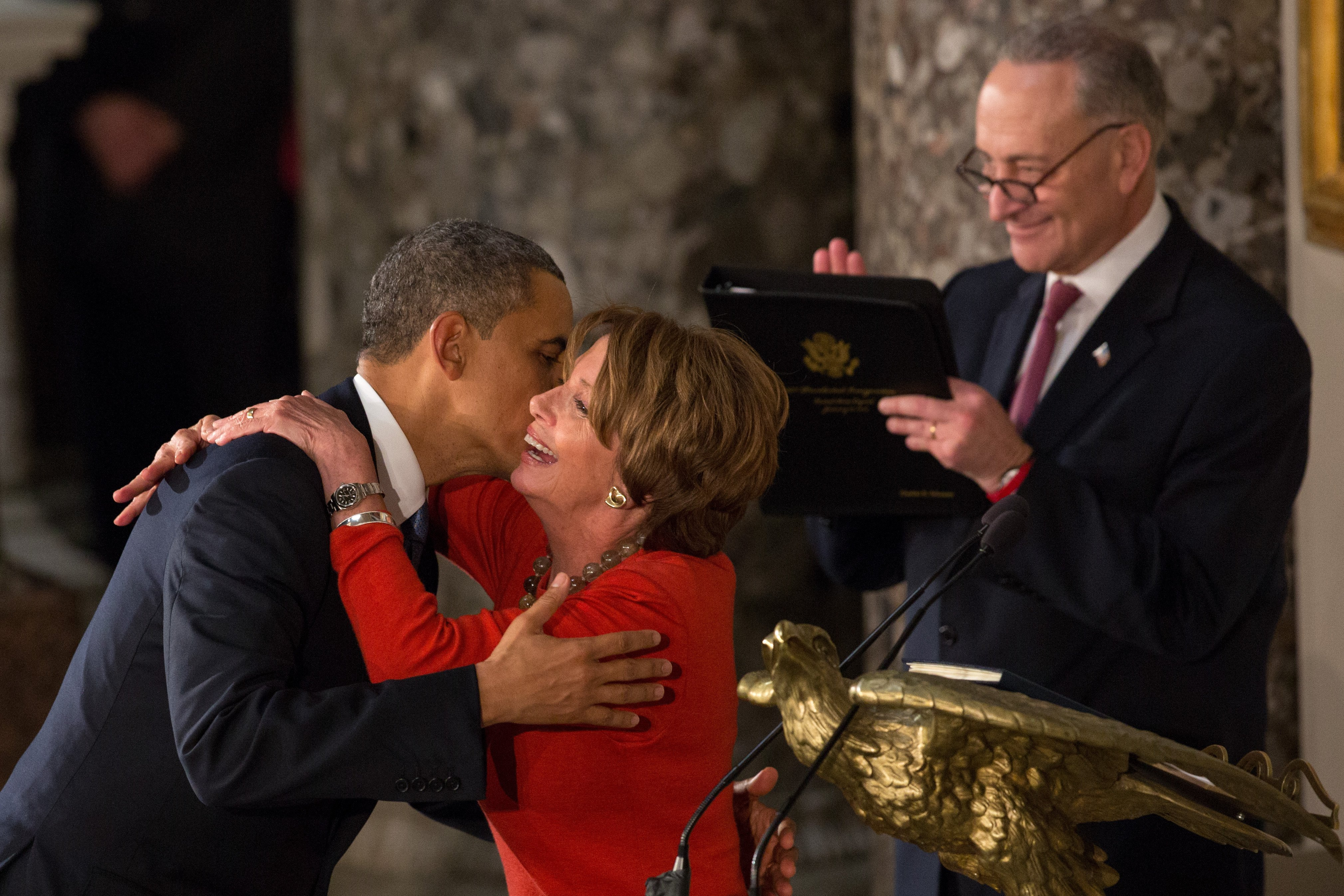 Barack Obama and Nancy Pelosi greeting each other at the Inaugural Luncheon in Statuary Hall in 2013 | Photo: Getty Images