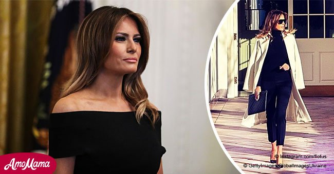 Melania accentuates her elegance in a chic white coat while walking in the White House grounds