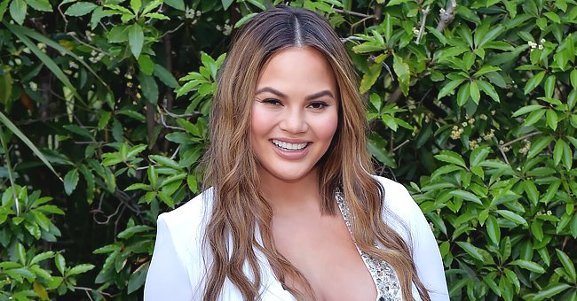 Chrissy Teigen Shares Adorable Video of Daughter Luna Using Floss Picks to Check Mom's Teeth