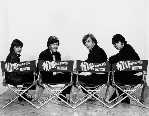 The Monkees members smiling while seated head over shoulder, undated picture. | Photo: Getty Images