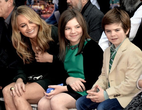 Christine Taylor and her children Ella Stiller and Quinlin Stiller watch as actor Ben Stiller is honored with a hand and footprint ceremony at the TCL Chinese Theatre on December 3, 2013, in Los Angeles, California. | Source: Getty Images.