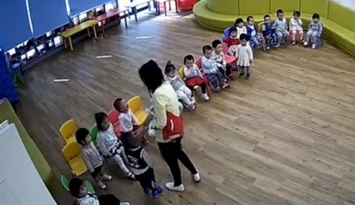 Screenshot showing daycare worker force-feeding children. | Source: YouTube/News & Politics #17