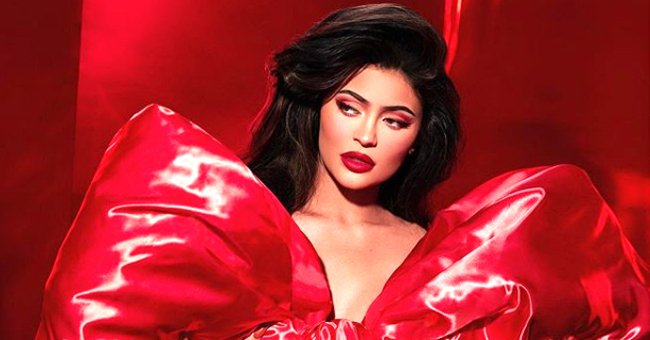 Kylie Jenner Puts Her Curves on Display in Skintight Red Dress as She Promotes Kylie Cosmetics' Holiday Collection