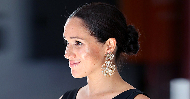 Meghan Markle Pairs Jumpsuit with Gold Earrings for 1st Solo Engagement of South Africa Royal Tour