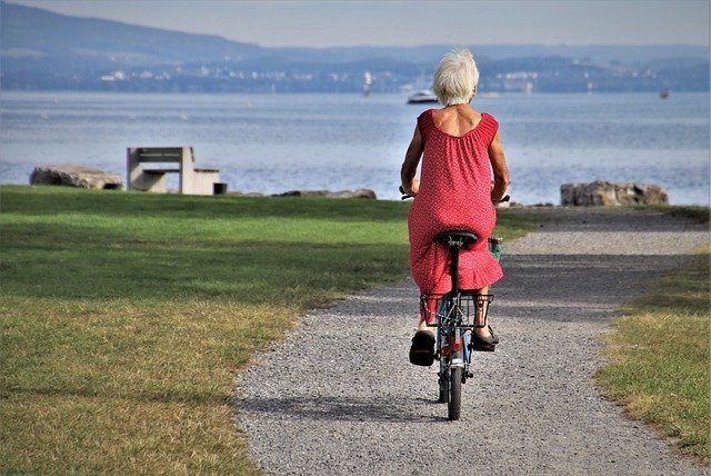 An elderly woman taking a ride on a bicycle by the sea. I Image: Getty Images.