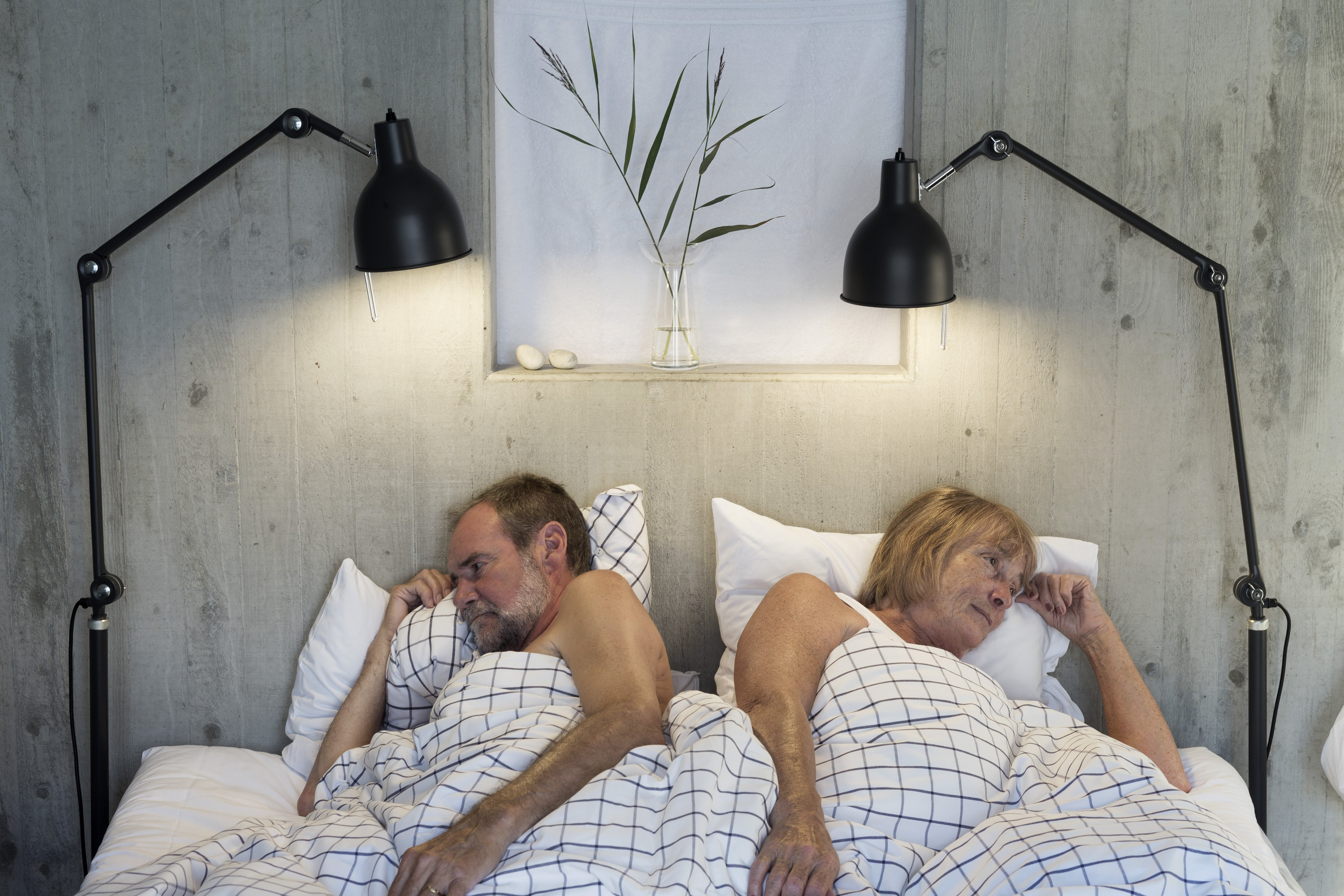 Elderly couple in bed with their backs to each other   Source: Shutterstock
