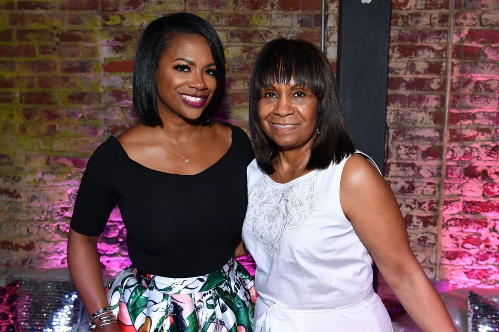 "Kandi Burruss and her mother, Mama Joyce Burruss attending the Kandi Cares ""A Mother's Love Dinner"" in May 2018. 