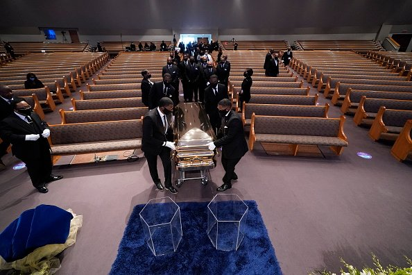 The casket bearing the remains of George Floyd is brought into the chapel for his funeral service at the Fountain of Praise church June 9, 2020 in Houston, Texas | Photo: Getty Images