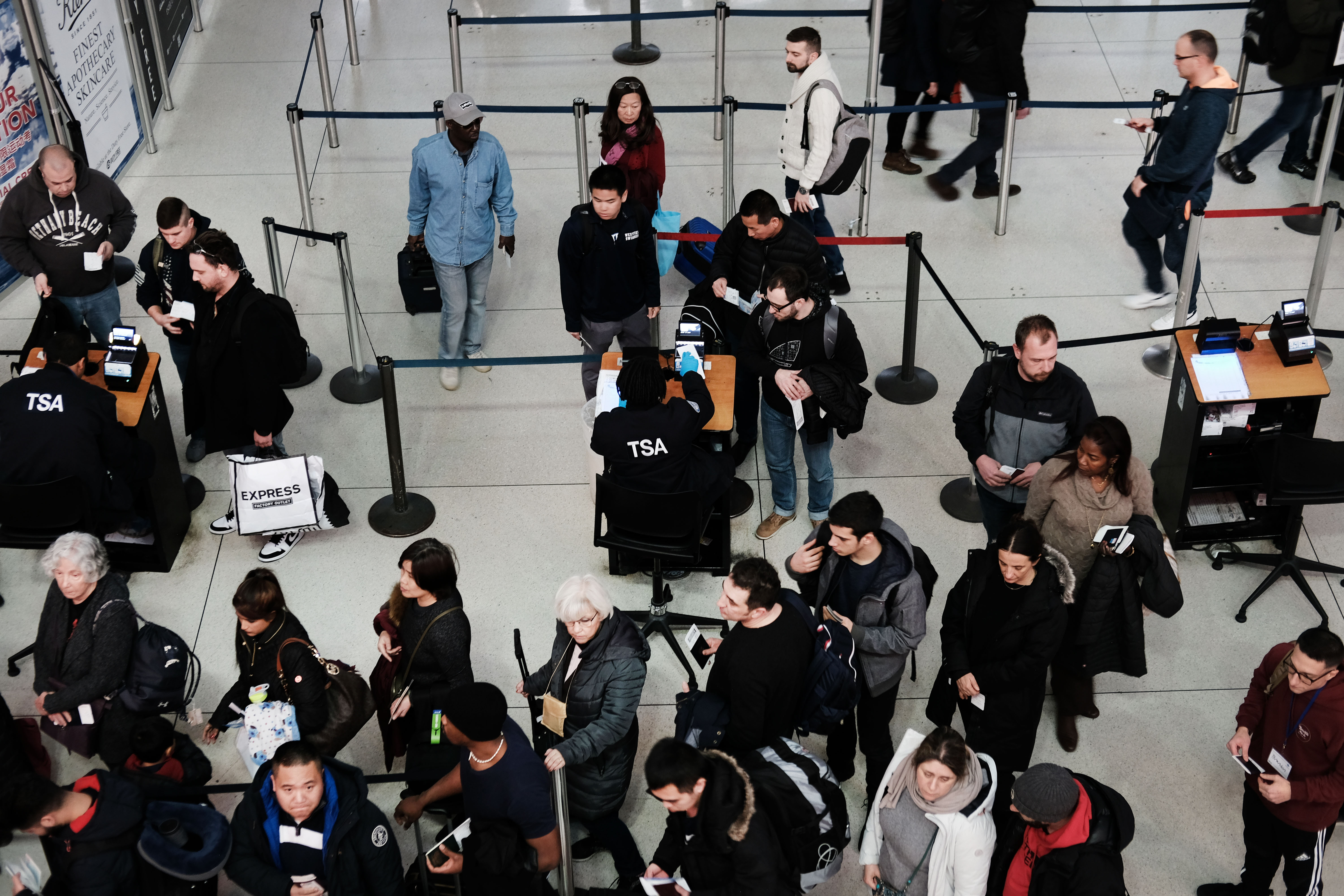 Passengers waiting for their luggage to be checked by TSA at the JFK Airport in New York City | Photo: Getty Images