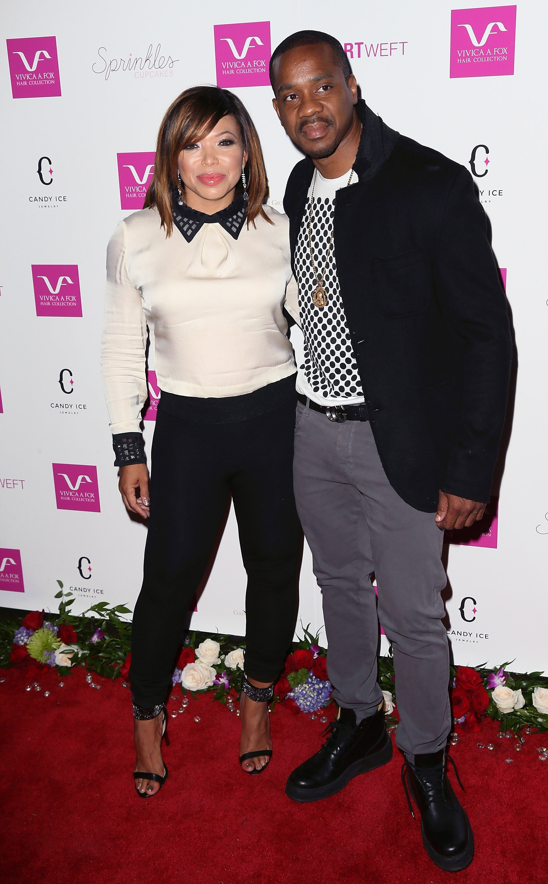 Tisha Campbell & Duane Martin at Vivica A. Fox's 50th birthday celebration on Aug. 2, 2014 in California | Photo: Getty Images