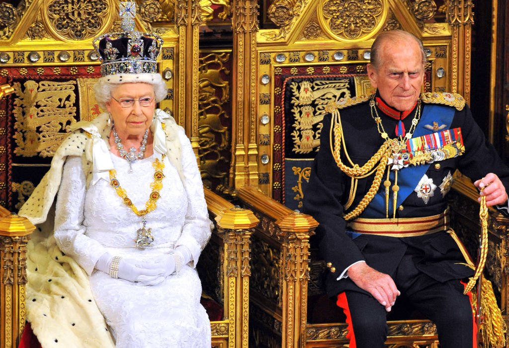 Queen Elizabeth II sits with Prince Philip at the Palace of Westminster on June 4, 2014, in London, England   Source: Getty Images