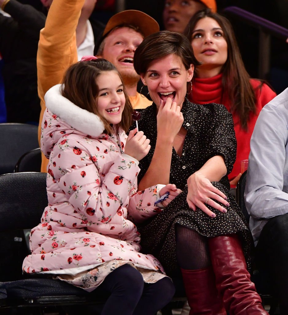 Suri Cruise and Katie Holmes attend the Oklahoma City Thunder Vs New York Knicks game at Madison Square Garden. | Photo: Getty Images