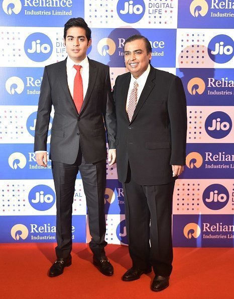 Mukesh Ambani and Akash at the 42nd AGM of Reliance Ind. Ltd in Mumbai, India. | Photo: Getty Images