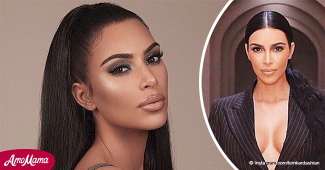 Kim Kardashian puts her chest on full display as she goes topless under a pinstripe blazer