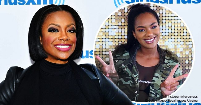 Kandi Burruss' daughter shows off slimmer figure in sheer top & camo jacket after losing 50 lbs