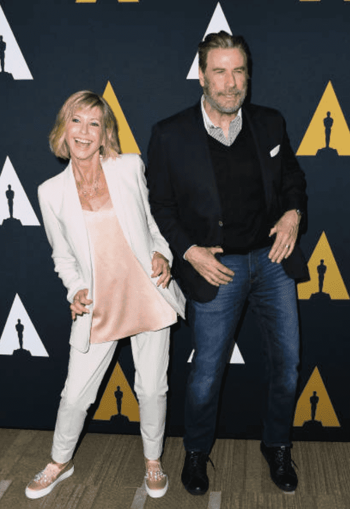 "Olivia Newton-John and John Travolta dance for cameras on the red carpet for the 40th Anniversary of ""Grease,"" at Samuel Goldwyn Theater, on August 15, 2018 in Beverly Hills, California 
