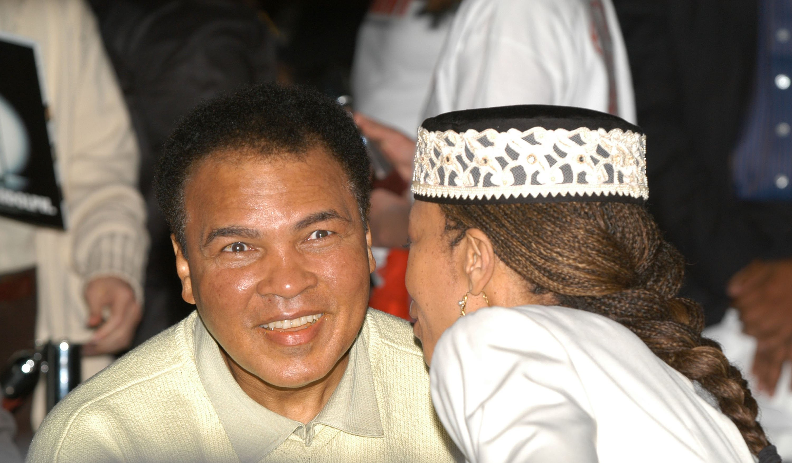 """Malcolm X's daughter, Attallah, speaks with Muhammad Ali as they attend the Miami Art Basel Taschen book premiere of Muhammad Ali's book, """"GOAT - Greatest Of All Time"""" at the Miami Convention Center December 6, 2003 in Miami, Florida.