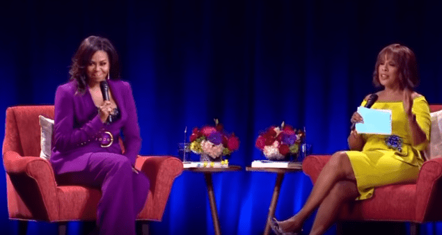 Michelle Obama and Gayle King on stage at the State Farm Arena, Atlanta, on May 11, 2019. | Source: YouTube/11Alive