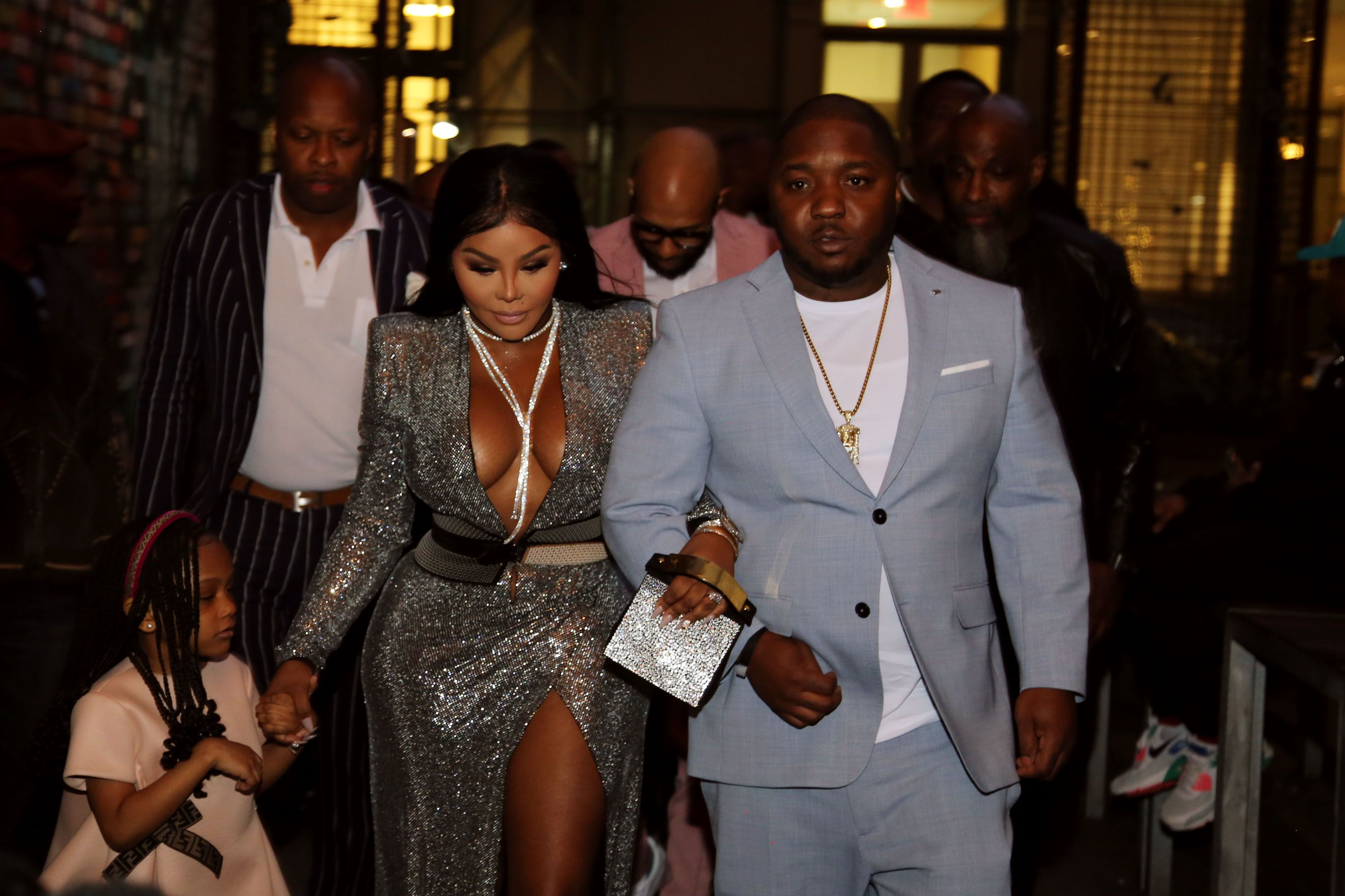 Lil' Kim with daughter Royal Reign and Lil' Cease at her 1st Annual B.I.G. Family Dinner in 2019 in New York City | Source: Getty Images