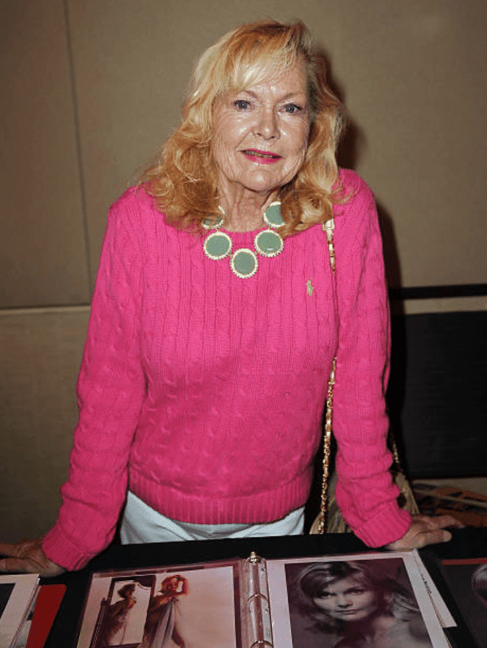 "Carol Lynley posing with a catalogue of her pictures at ""The Hollywood Show"" on April 20, 2013, in Los Angeles, California 