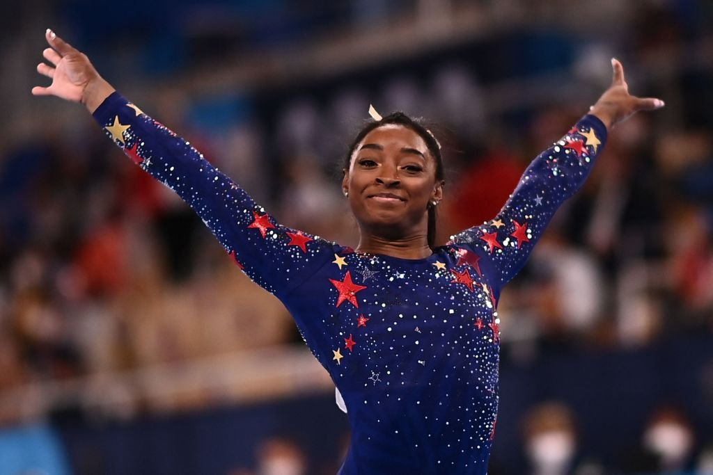 Simone Biles in the artistic gymnastics balance beam event during the Tokyo 2020 Olympic Games, on July 2021.   Source: Getty Images