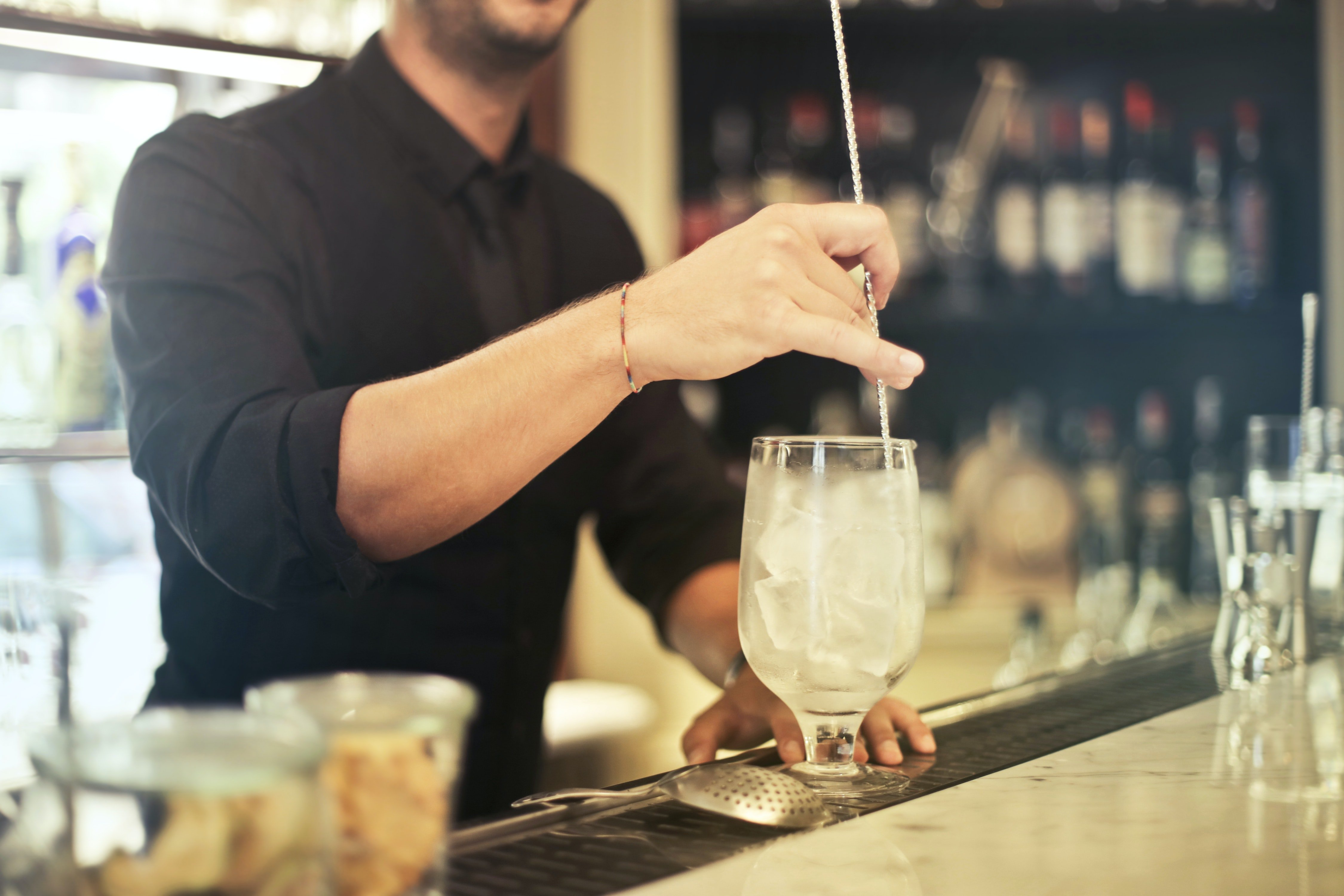 A bartender whipping up a drink.   Photo: Pexels/Andrea Piacquadio