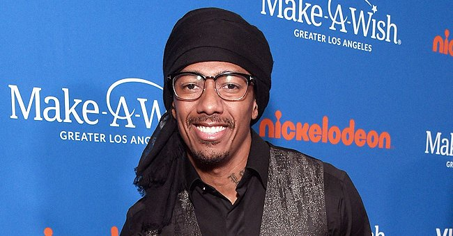 Check Out Brittany Bell & Nick Cannon Posing in Bunny Ears with Their Kids in a Family Photo