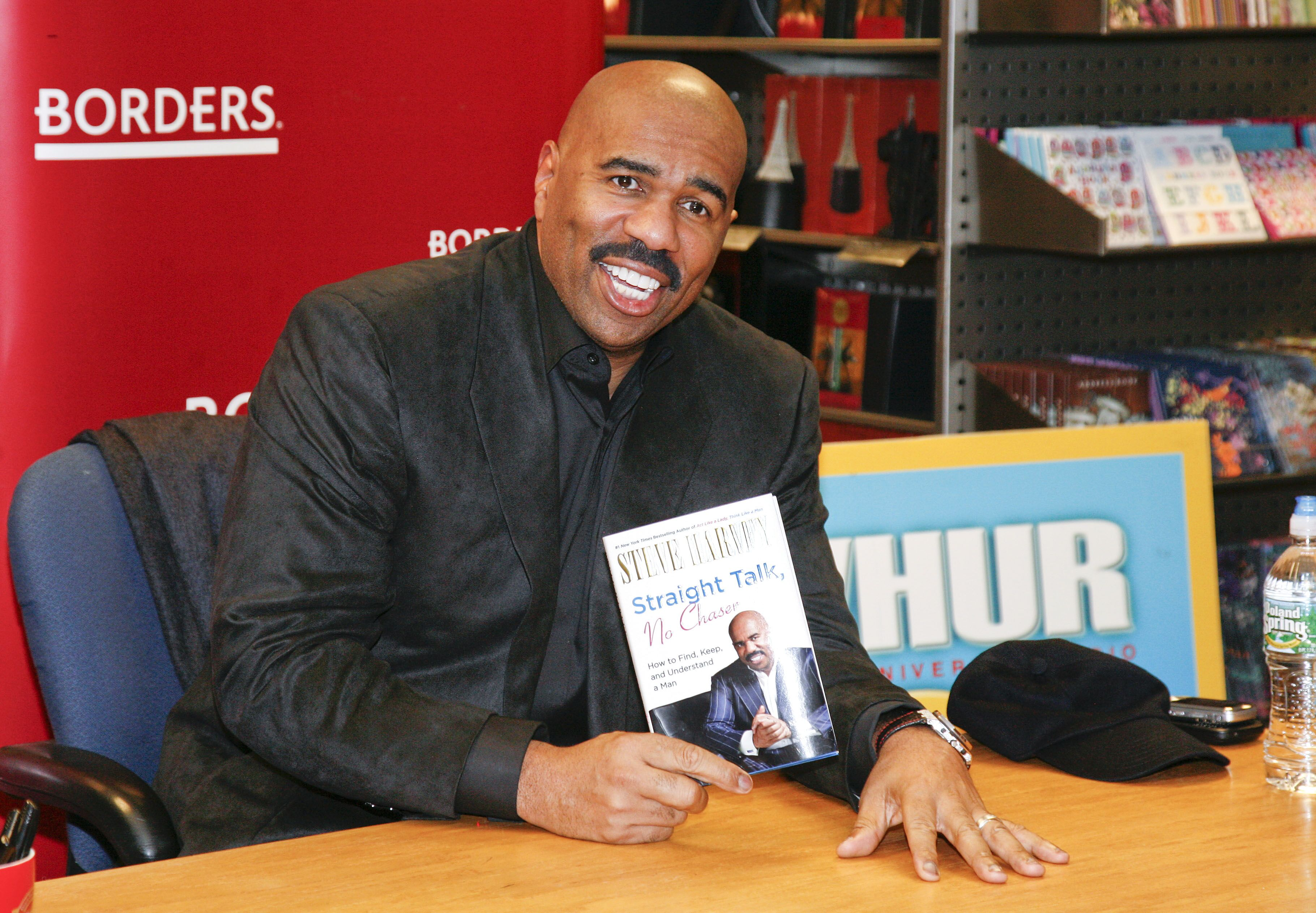 """Steve Harvey signs copies of his book """"Straight Talk, No Chaser"""" in Washington in 2011 