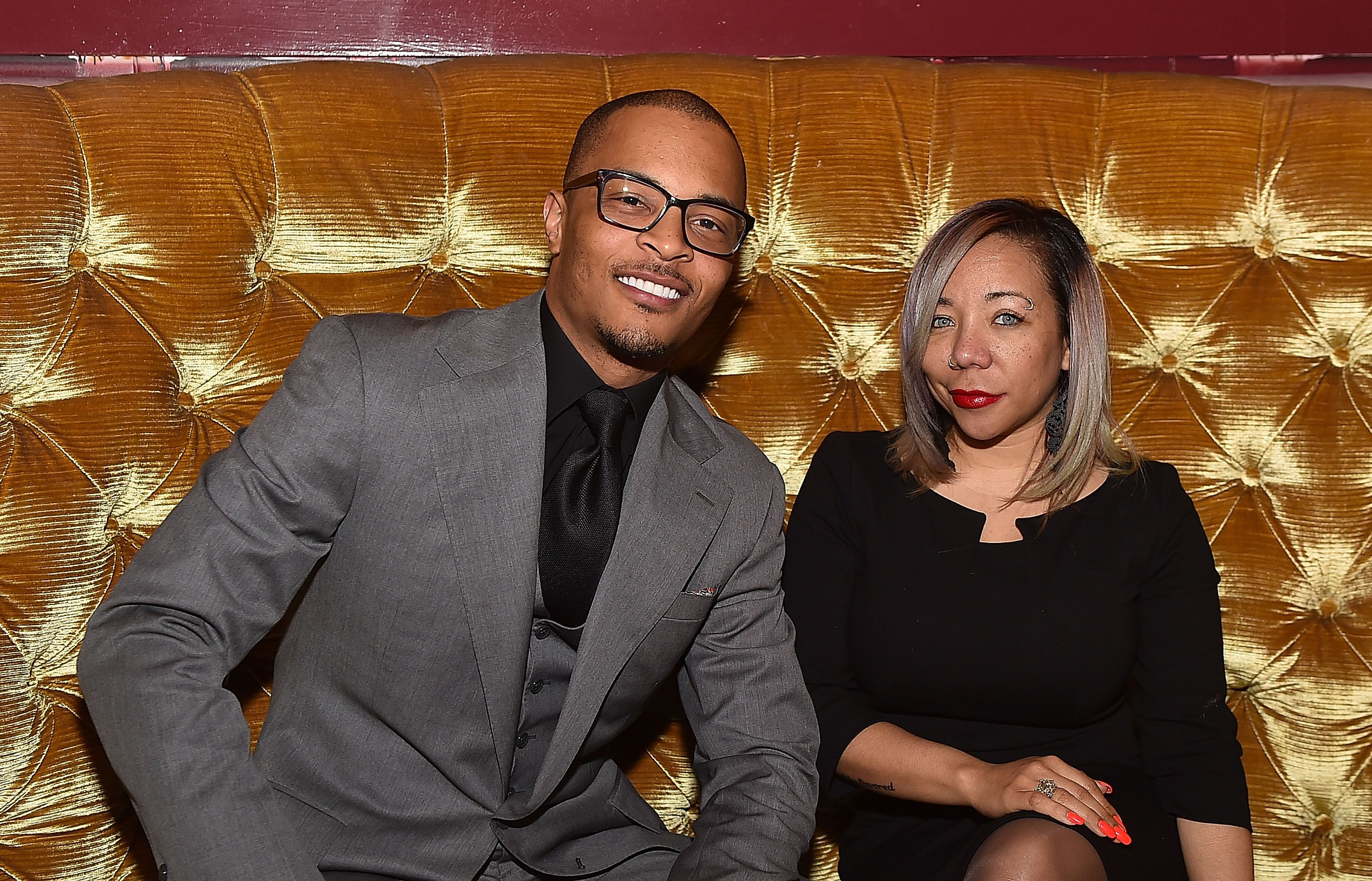 """Rapper Clifford """"T.I."""" Harris and Tameka """"Tiny"""" Harris at the Scales 925 Restaurant ribbon cutting ceremony on March 27, 2015 
