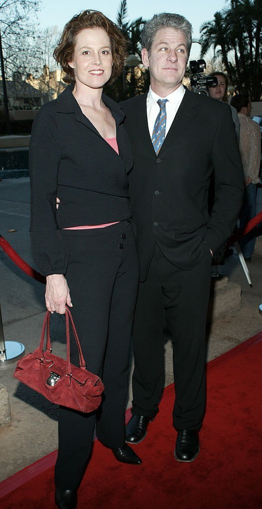 Sigourney Weaver and her husband Tim Simpson. I Image: Getty Images.