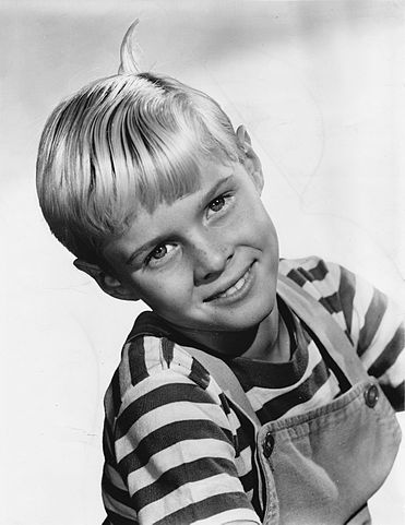 "Jay North posing for a publicity photo for ""Dennis the Menace."" 