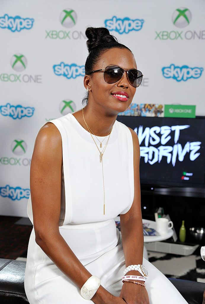 Aisha Tyler checks out Sunset Overdrive on Xbox One the Microsoft VIP Lounge during Comic-Con on July 26, 2014 in San Diego, California. | Source: Getty Images