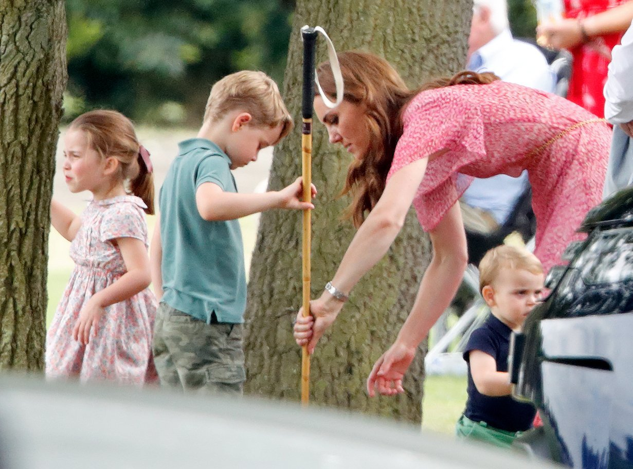 Princess Charlotte, Prince George, Duchess Kate, and Prince Louis at the King Power Royal Charity Polo Day | Photo: Getty Images