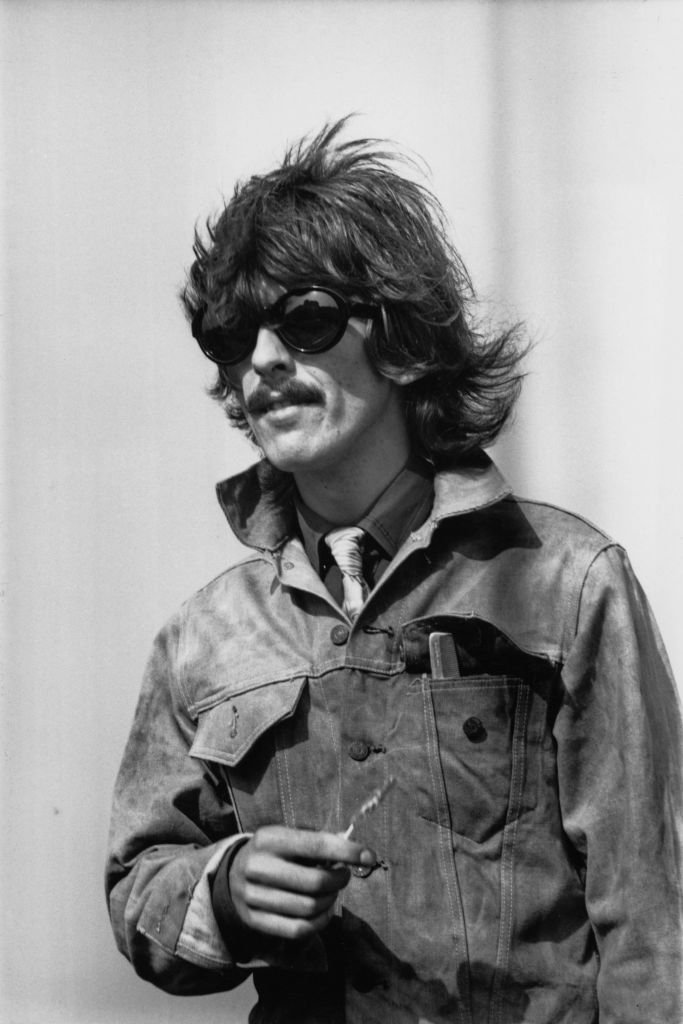 English guitarist, singer and songwriter George Harrison (1943 - 2001) of the Beatles at London Airport, UK | Getty Images / Global Images Ukraine