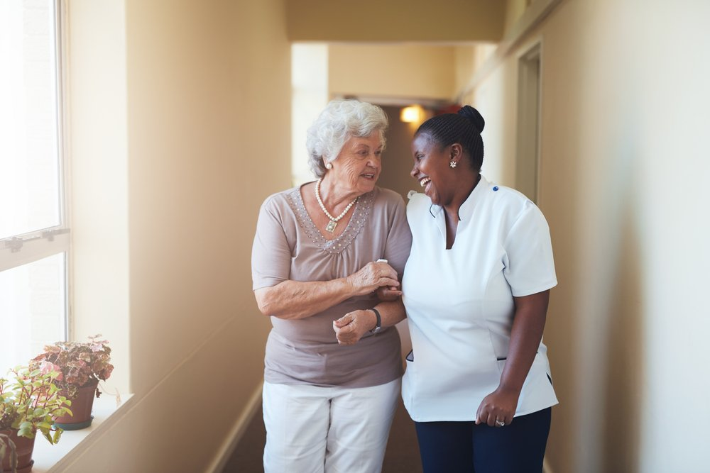 Professional caregiver taking care of elderly woman   Photo: Shutterstock