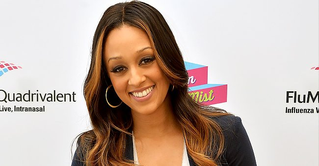 'Sister, Sister' Star Tia Mowry Makes Hearts Swell in a Tight off-Shoulder Black Dress (Photo)