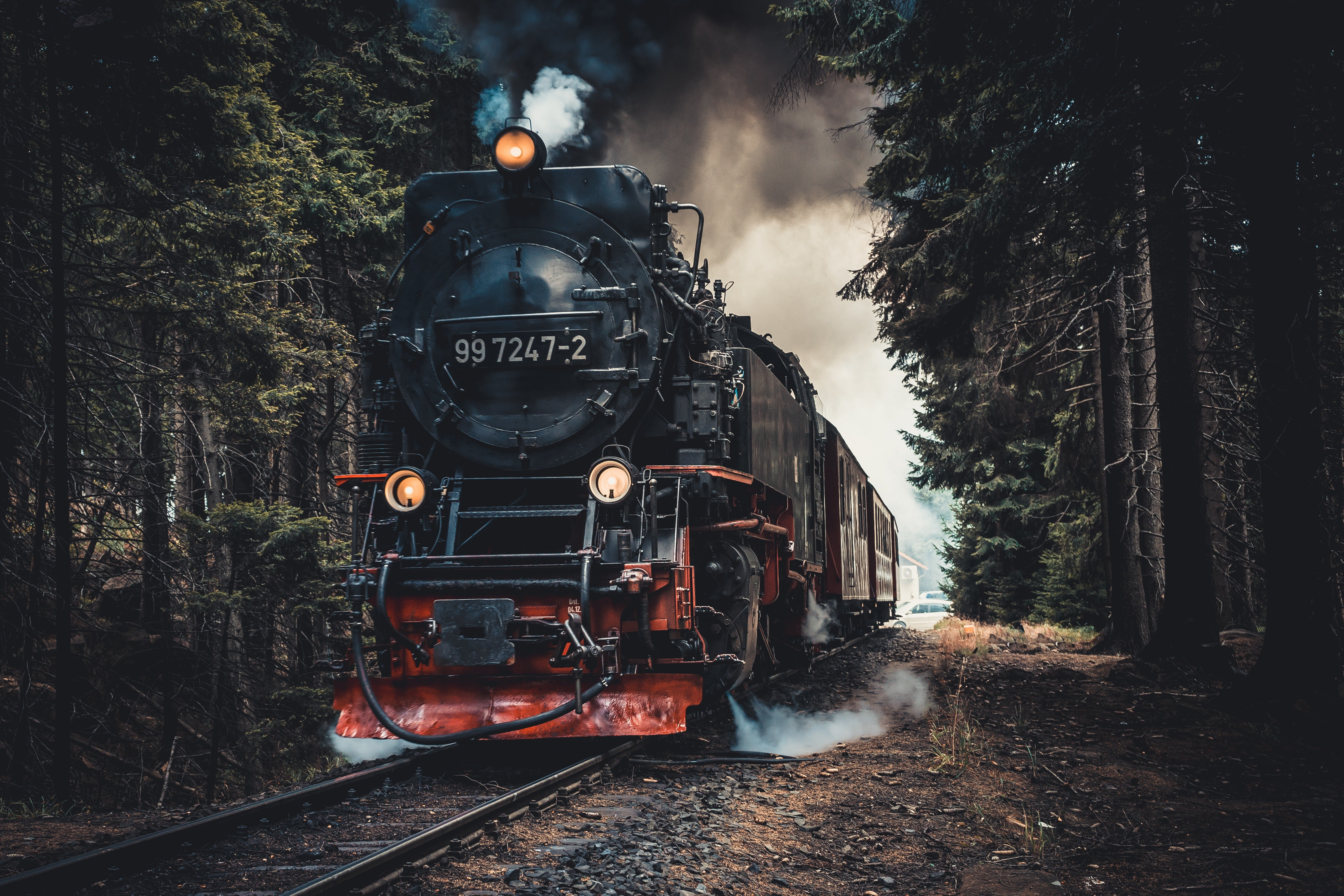 Pictured - A red and black train steam locomotive on a railway | Source: Pexels