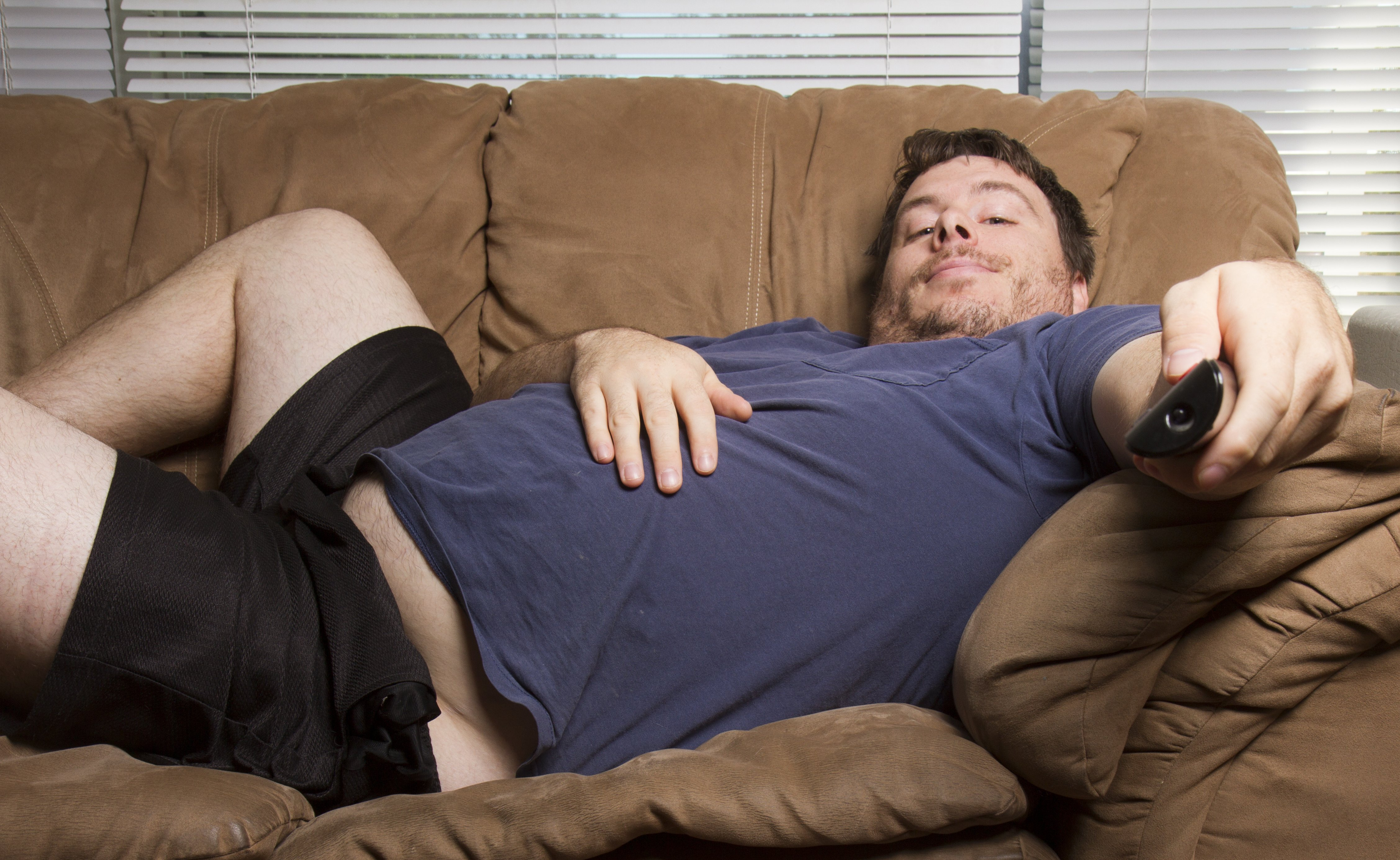 Lazy man on couch   Source: Shutterstock