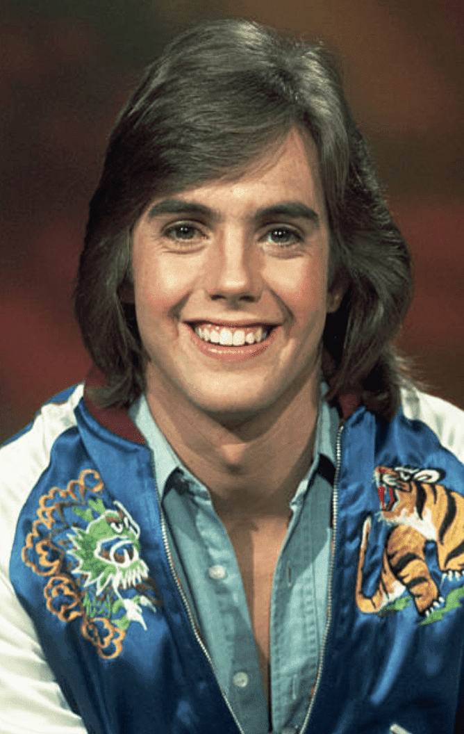 Shaun Cassidy poses for a picture while filming a commercial for National Foundation March of Dimes | Getty Images