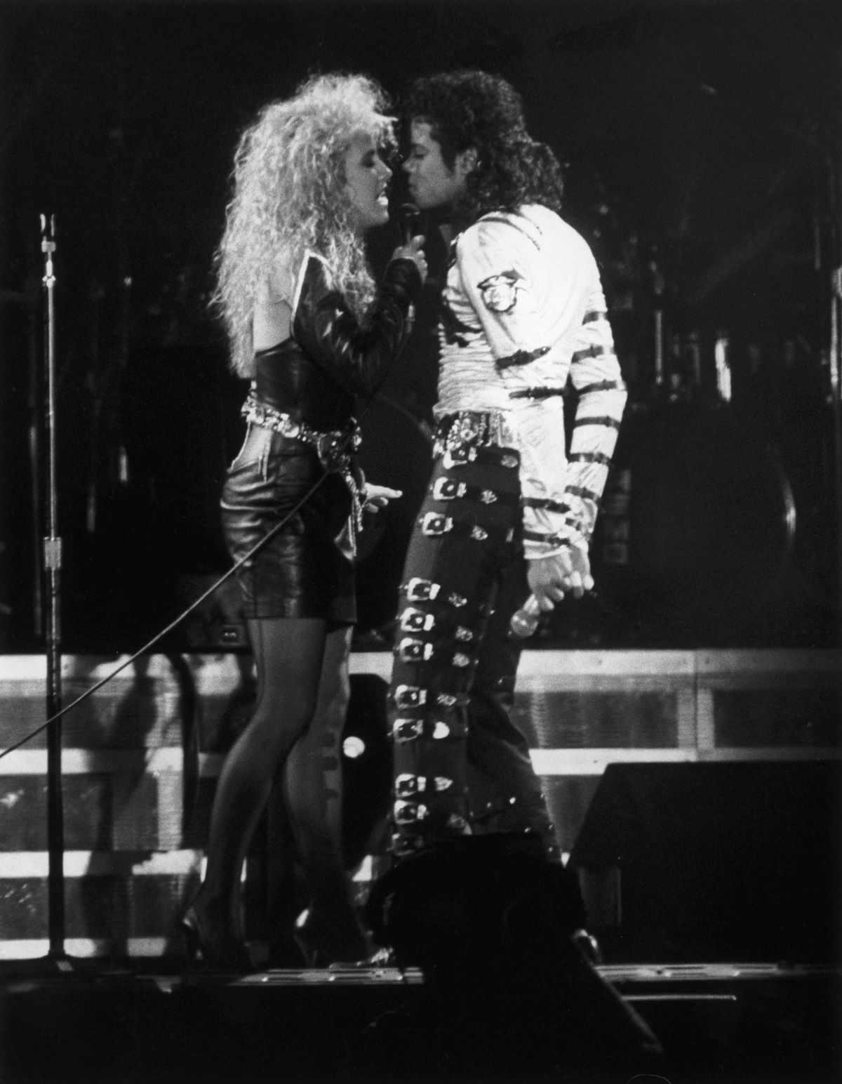 Pop star Michael Jackson performs a duet with backing singer Sheryl Crow during a concert in Rome, May 1988. | Getty Images