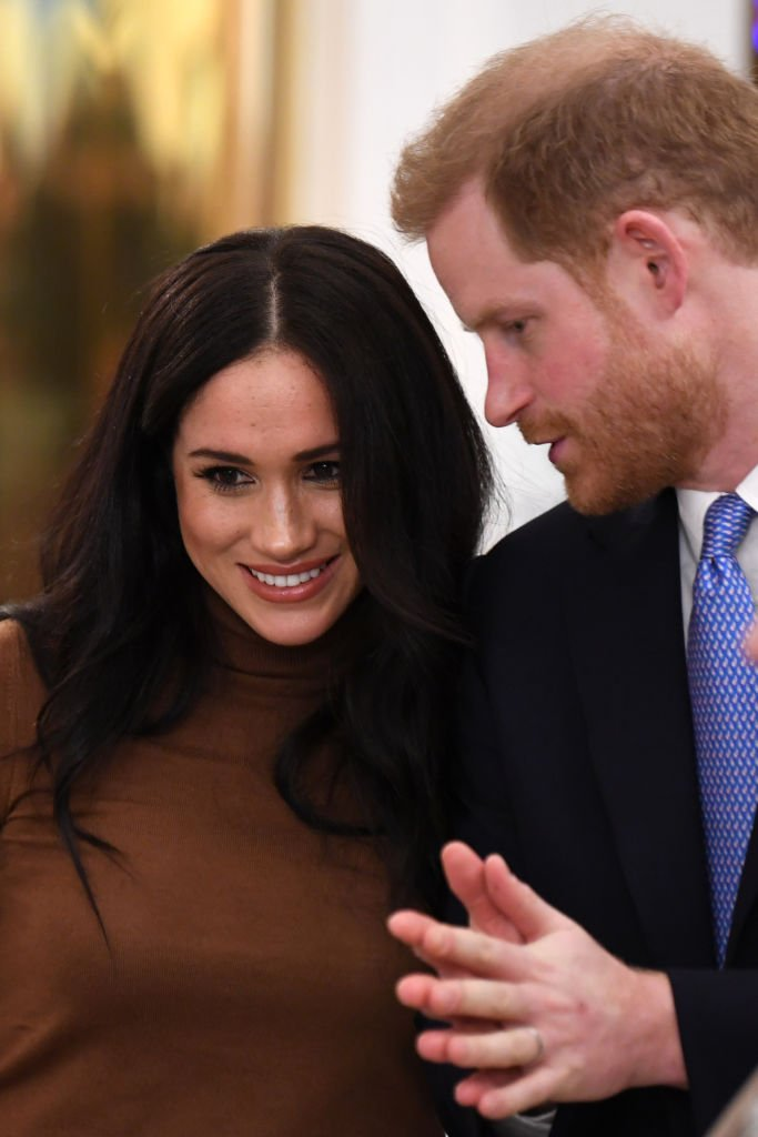 Prince Harry, Duke of Sussex and Meghan, Duchess of Sussex gesture during their visit to Canada House in thanks for the warm Canadian hospitality and support they received during their recent stay in Canada, | Photo: Getty Images