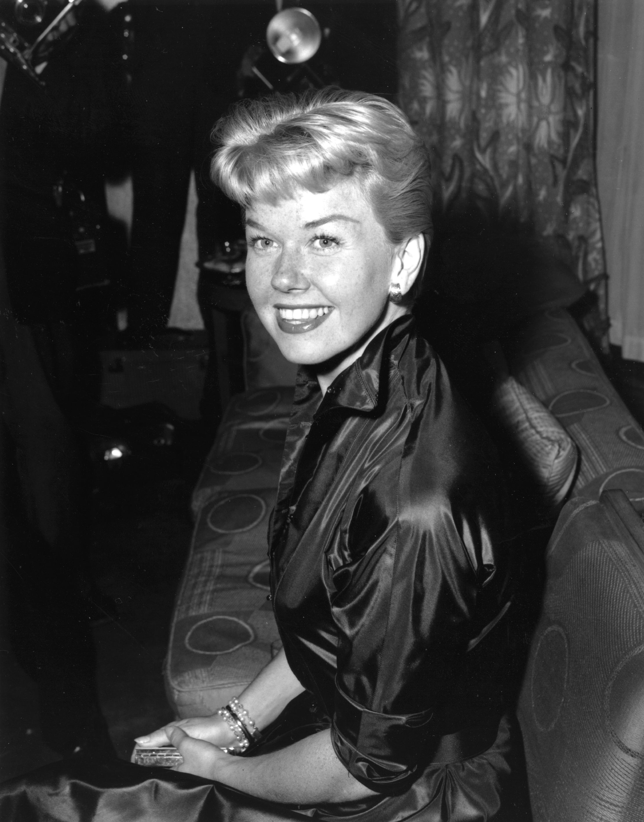 Doris Day attends a reception at Claridges Hotel in London, April 1955. | Source: Getty Images.