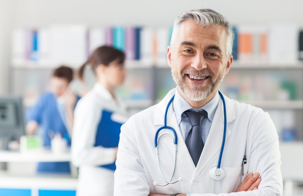 A doctor smiles at the camera. | Source: Shutterstock