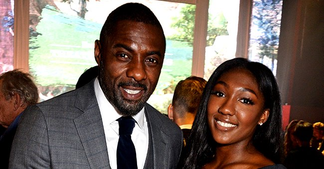 Idris Elba's Daughter and Former Miss Golden Globe Isan Stuns in White Off-Shoulder Dress in Beachside Photo