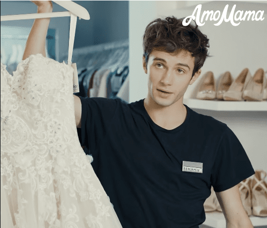 Trying on dresses | Source: Facebook/ AmoMama