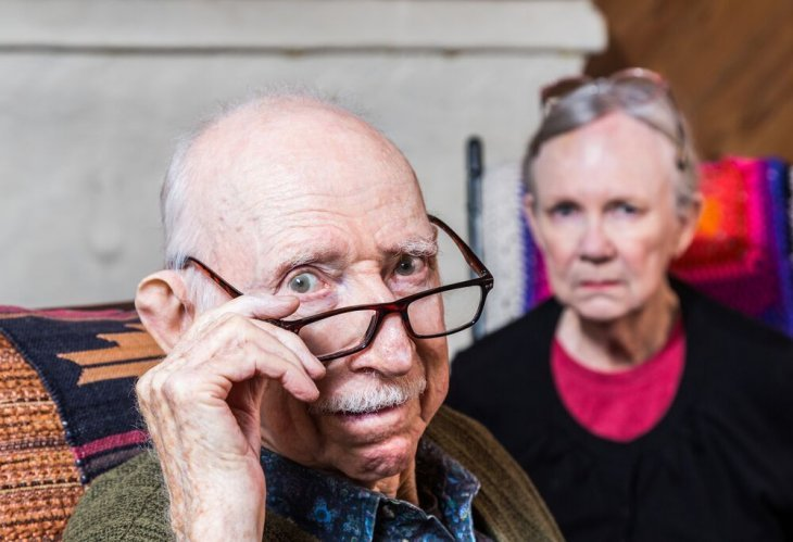 Worried old man with old woman | Source: Shutterstock