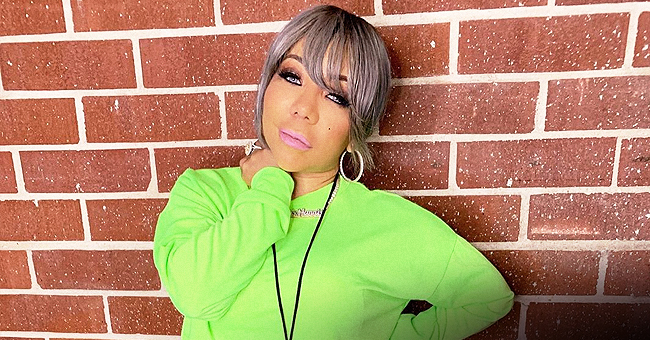 Tiny Harris Turns Heads in a Tight Mini Dress with Deep Cleavage