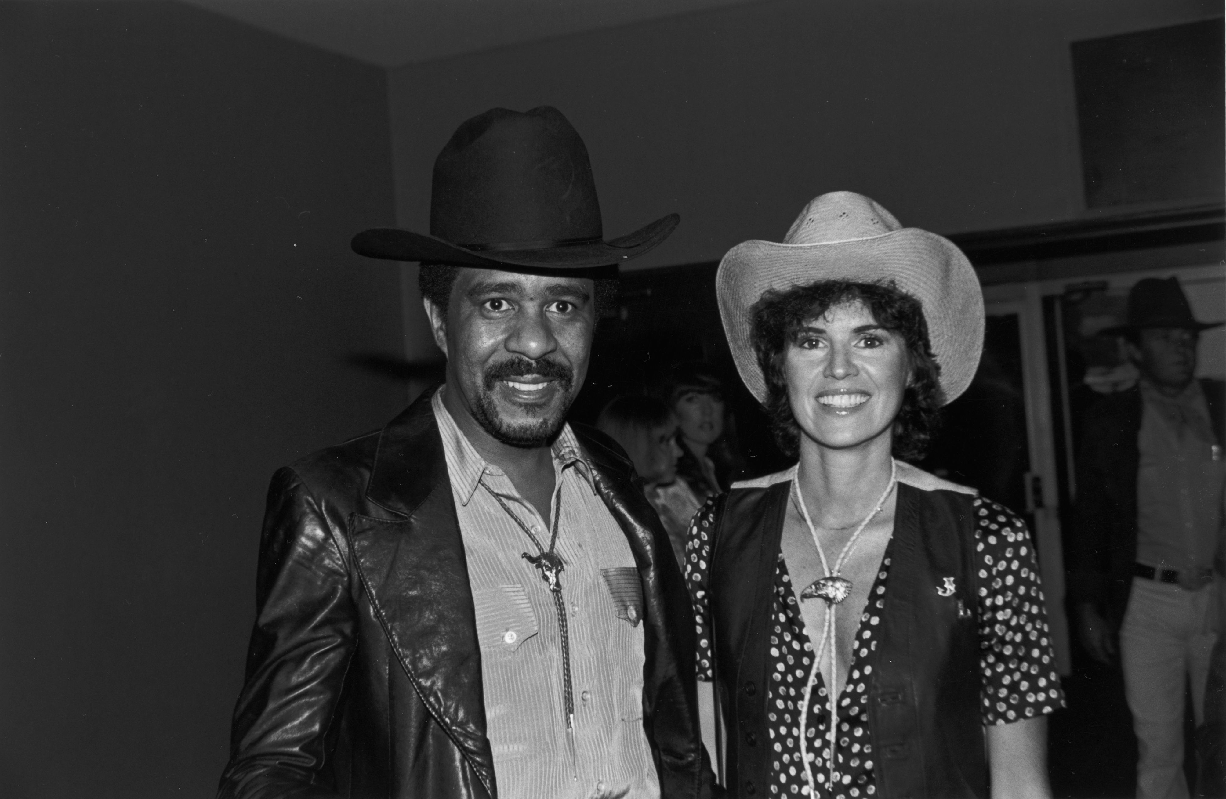 Richard Pryor and Jennifer Lee wearing cowboy hats and bolo ties, smile while at the annual SHARE party, held at the Hollywood Palladium, Hollywood, California.   Source: Getty Images