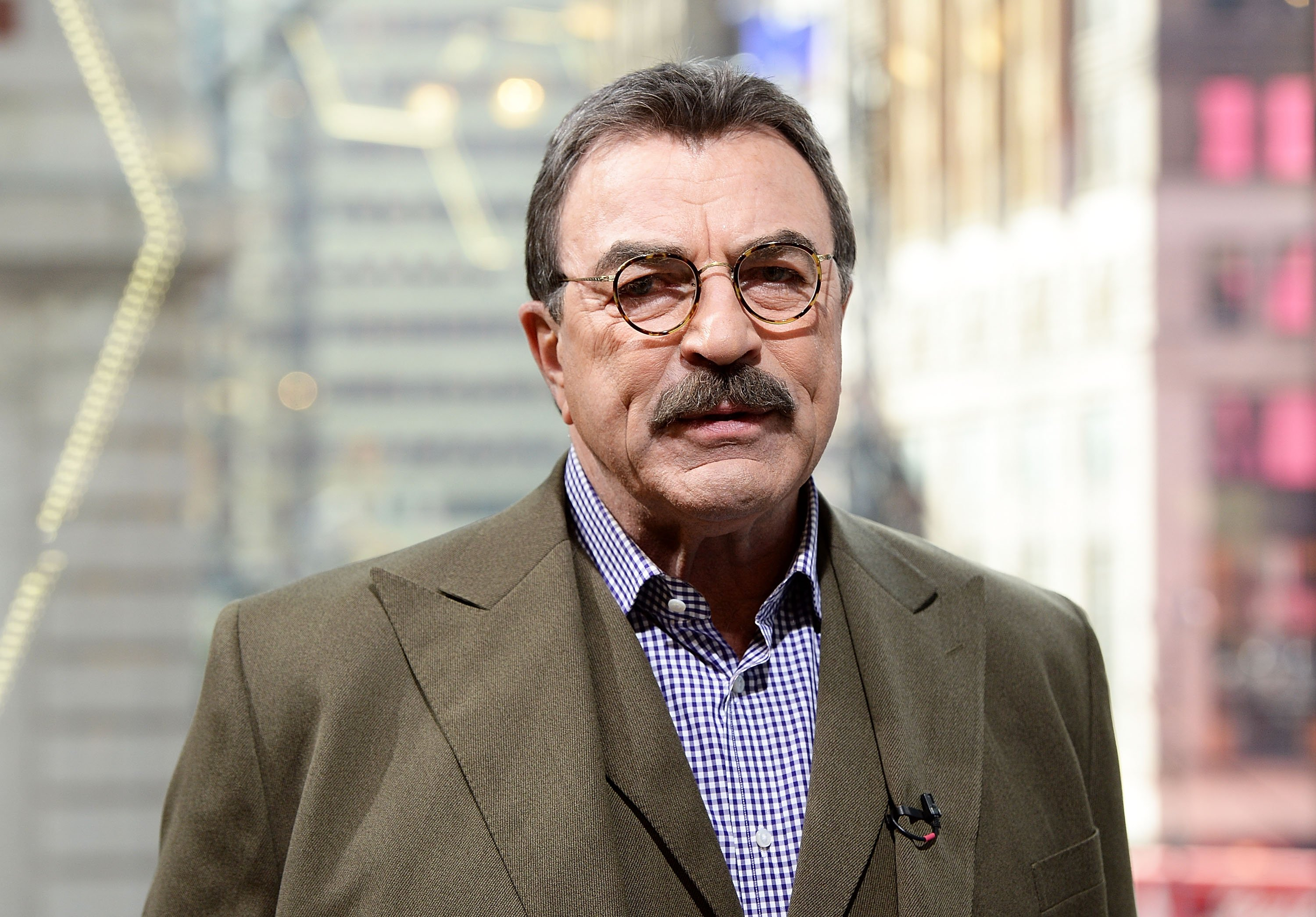 """Actor Tom Selleck visits """"Extra"""" at H&M Times Square on October 15, 2015. 